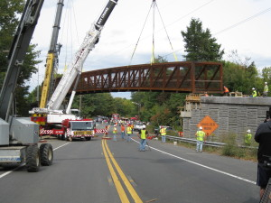 The Manhan Rail Trail bridge over Route 10 is lowered onto abutments September 26, 2010.