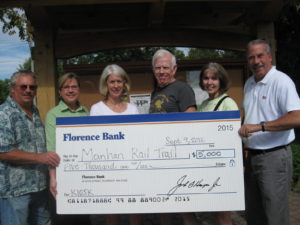 Florence Savings Bank officials present a $5,000 check to the Friends of the Manhan Rail Trail for the new kiosk September 9, 2016.